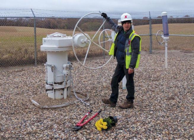 https://stopfossilfuels.org/civil-disobedience/valve-turners/michael-foster-keystone-1-pipeline-l.jpg